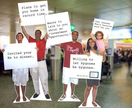 Lifesize cutouts of a family welcoming you home placed at airports as you come down the escalator.